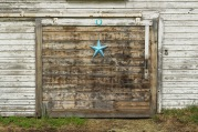 This frame shows a close-up of the ground floor door in the eastern side of the barn.