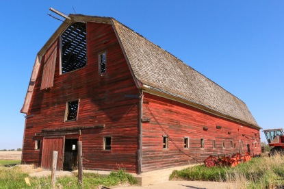 This frame shows the southern face and eastern side of the barn.